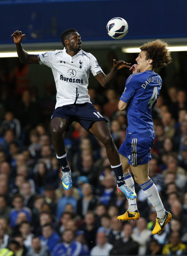 Chelsea's David Luiz, right, competes with Tottenham Hotspur's Emmanuel Adebayor during their English Premier League soccer m