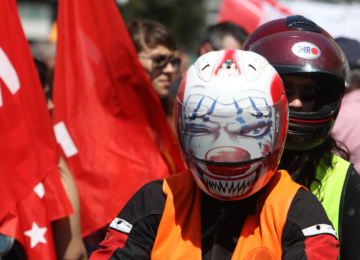 Protesters with motorcycles take part in a rally in Athens on Wednesday, May 1, 2013. About 8,000 people took part in the sub