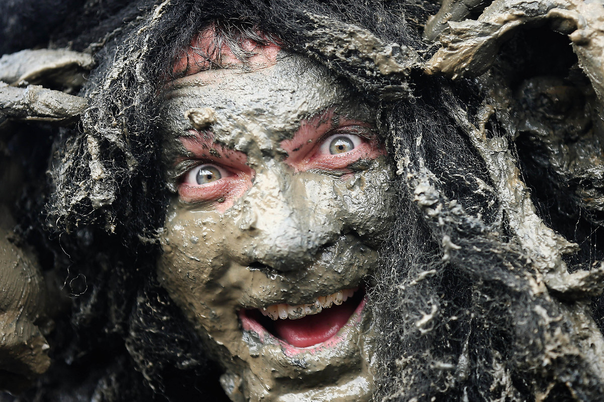 Joel Hicks, who was raising money for the 'Always With a Smile' charity, takes part in the Maldon Mud Race in Maldon, Essex o