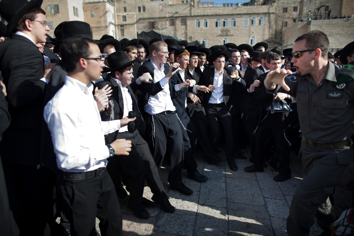 JERUSALEM, ISRAEL - MAY 10:  Ultra-Orthodox protestors clash with Israeli police officers during a prayer service held by the