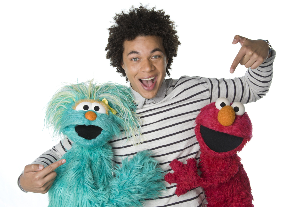 "This April 2013 photo released by Sesame Workshop shows Puerto Rican actor Ismael Cruz Cordova, 26, of ""Sesame Street,"" posin"