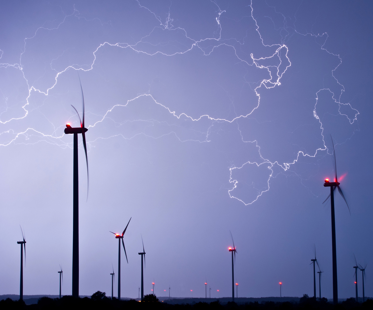 In this picture made available Friday, May 10, 2013, flashlights light the sky over a wind energy park during a thunderstorm