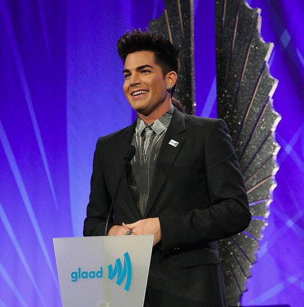 Adam Lambert gives a speech after accepting the 2013 Davidson/Velentini Award for oustanding music artist during the 24th Ann