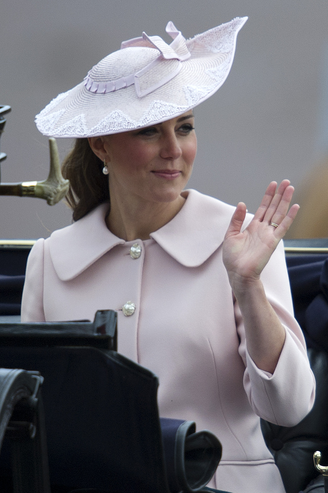 Britain's Catherine Duchess of Cambridge waves as she rides back to Buckingham Palace following the Queen's Birthday parade,