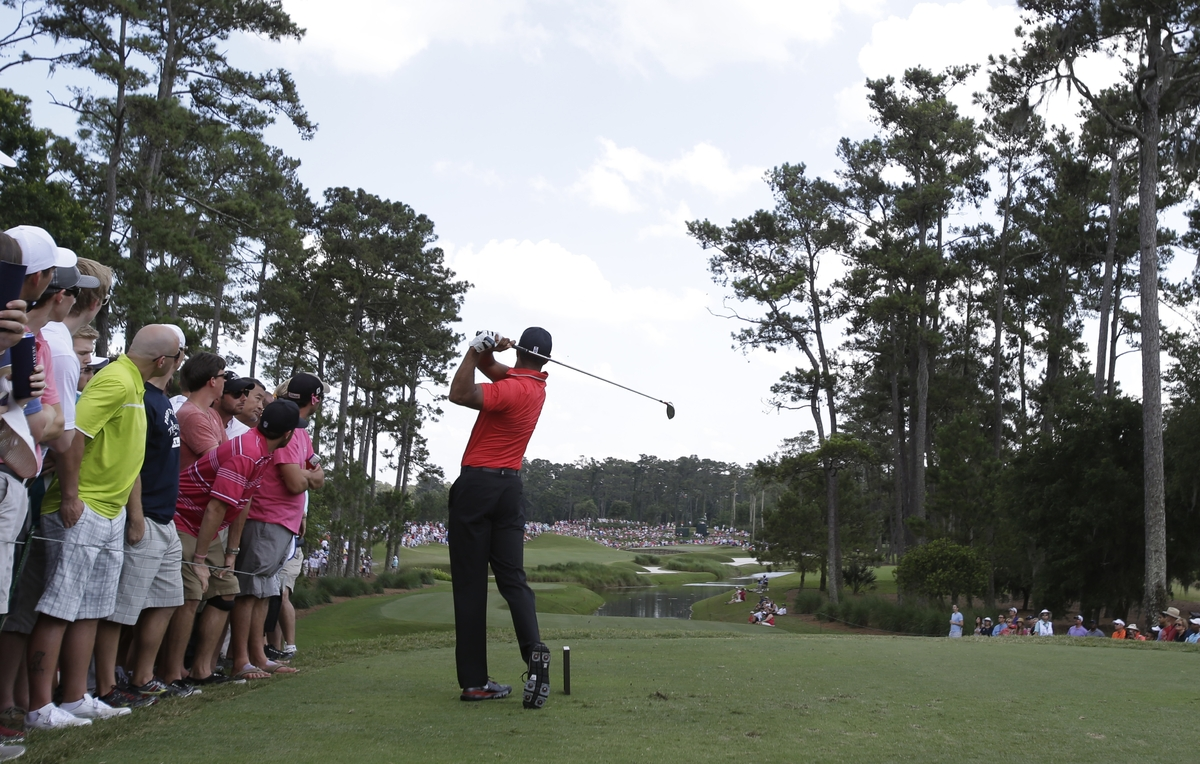 Tiger Woods hits from the fifth tee during the final round of The Players championship golf tournament at TPC Sawgrass, Sunda