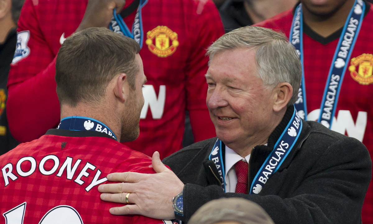 Manchester United's manager Sir Alex Ferguson, right, speaks to striker Wayne Rooney after his last home game in charge of th