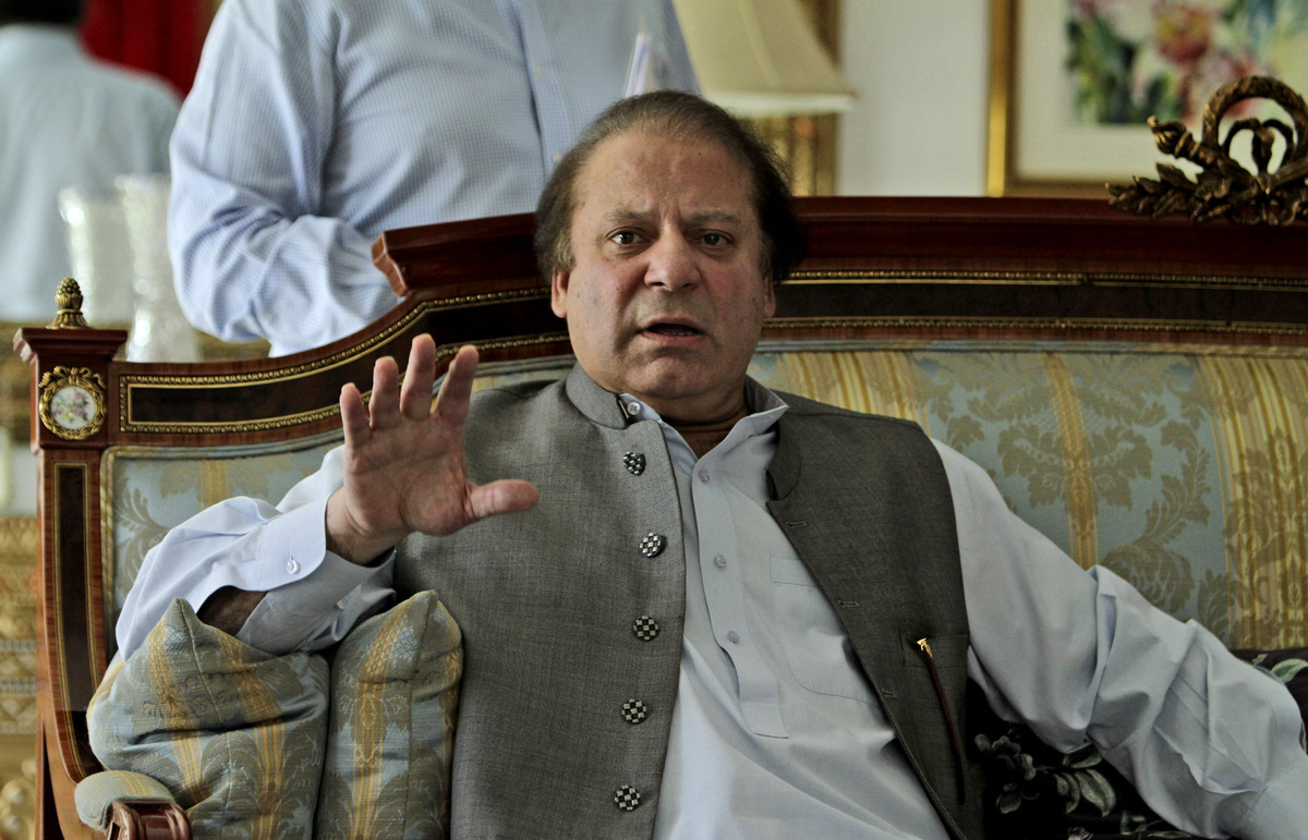 Former prime minister and leader of Pakistan Muslim League-N party, Nawaz Sharif, gestures while speaking to members of the m