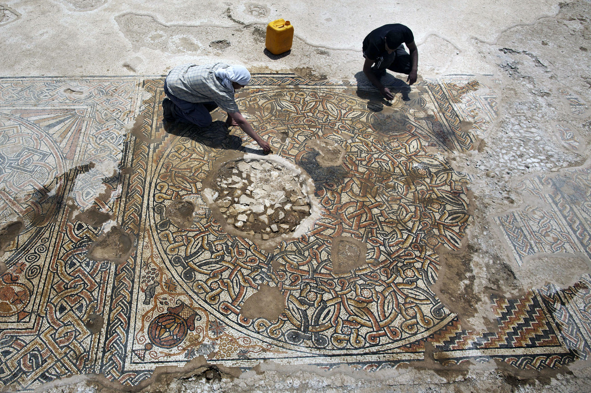Archaeologists of the Israeli Antiquities Authority work on a 1500-year-old Byzantine era mosaic floor near Kibbutz Beit Kama