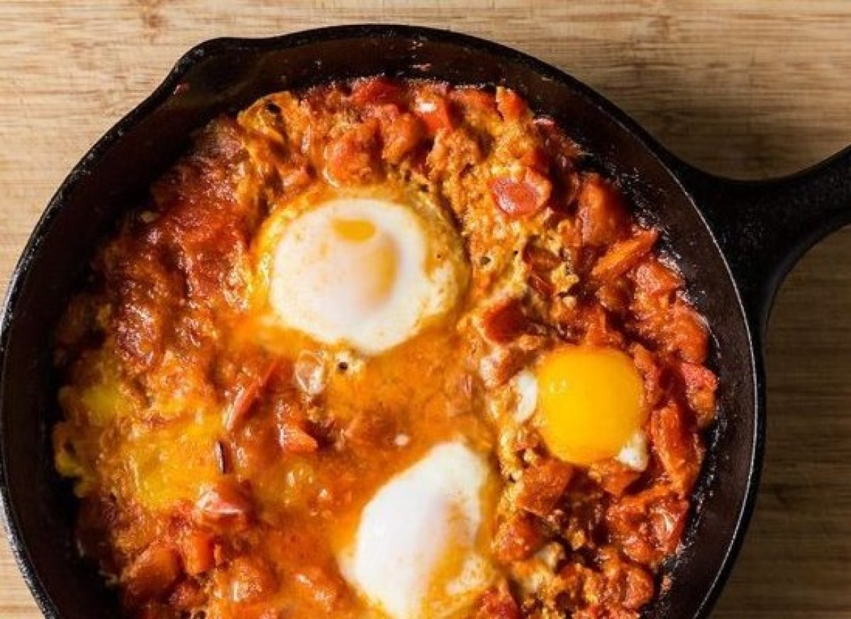 "<em><strong><a href=""http://food52.com/recipes/20281-tomato-y-yogurt-y-shakshuka"" target=""_hplink"">Get the recipe</a></strong"