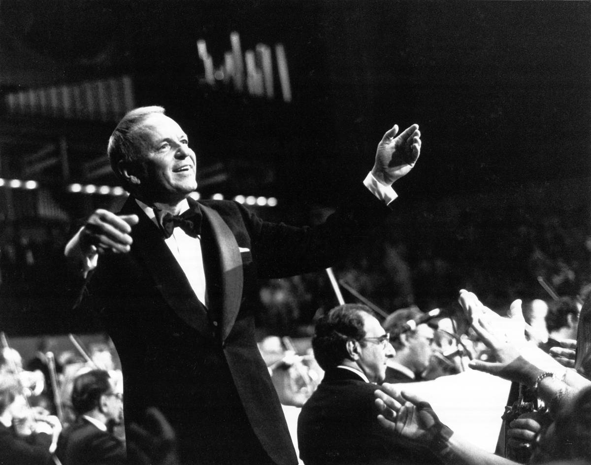 UNITED KINGDOM - SEPTEMBER 01:  ROYAL FESTIVAL HALL  Photo of Frank SINATRA, performing live onstage, conducting orchestra  (