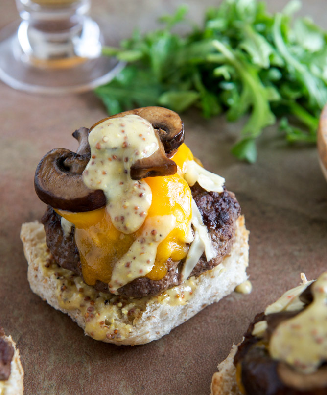 "<strong>Get the <a href=""http://www.howsweeteats.com/2013/04/cheeseburgers-with-sauteed-mushrooms-arugula-and-dijon-aioli/"" t"
