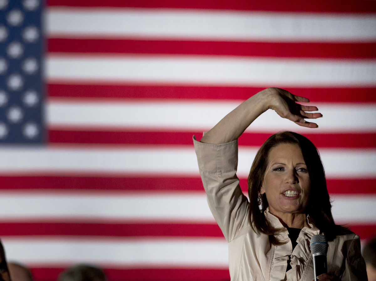 Rep. Michele Bachmann (R-Minn.) waves to the crowd during a welcome home event in her hometown of Waterloo, Iowa Sunday, June