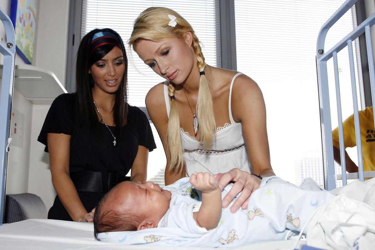 Kim Kardashian, Paris Hilton and Dallias Tupou (center) (Photo by John Stanton/WireImage)