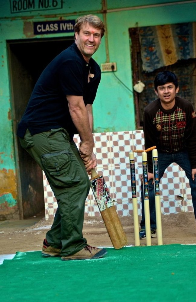 Author holding a cricket bat for the first time.