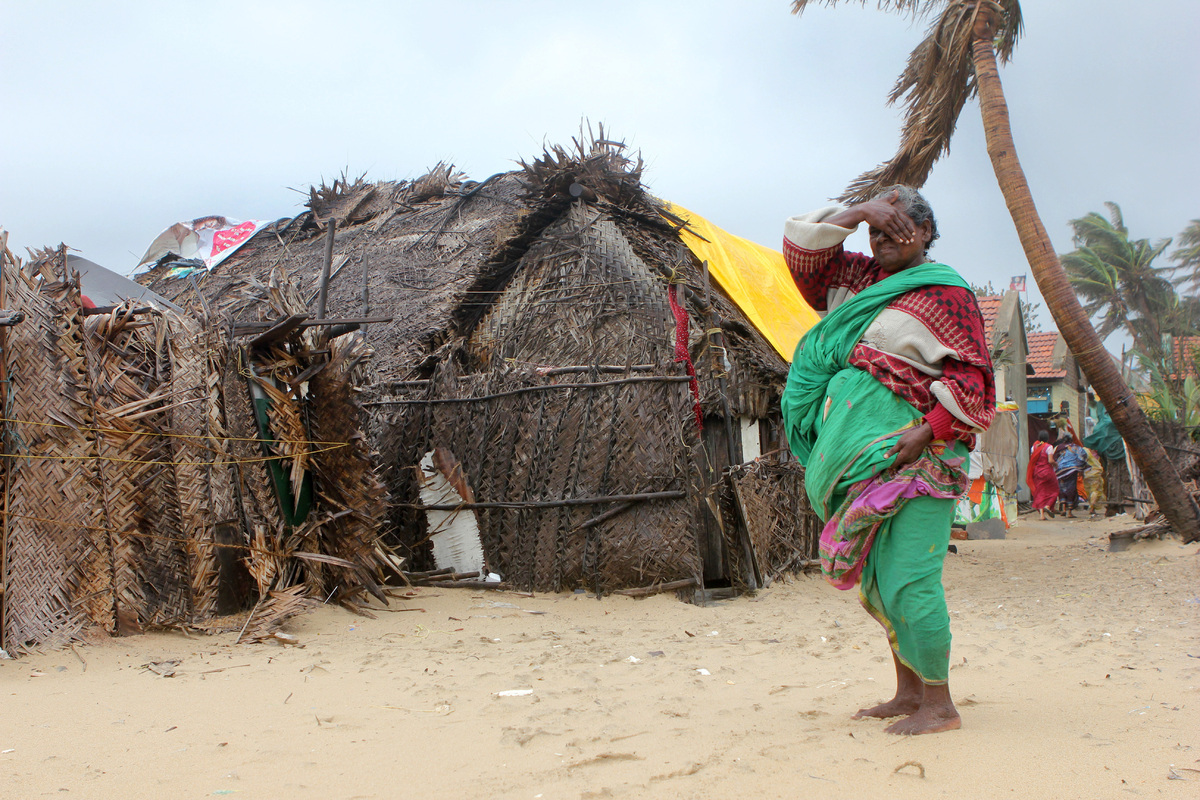 October: 210,000 displaced  <em>An Indian woman watches as the wind rises in the run up to Cyclone Nilam in Chennai on Octobe