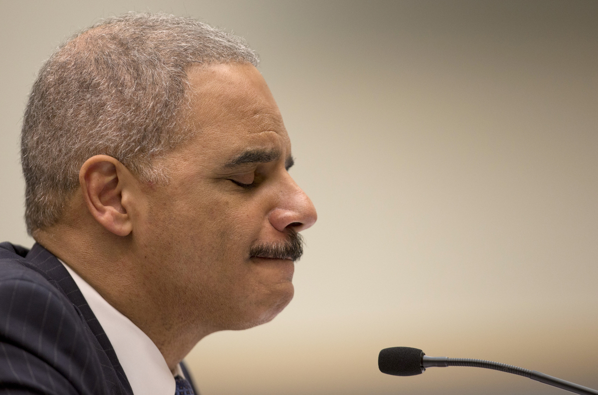 Attorney General Eric Holder pauses as he testifies on Capitol Hill in Washington, Wednesday, May 15, 2013, before the House