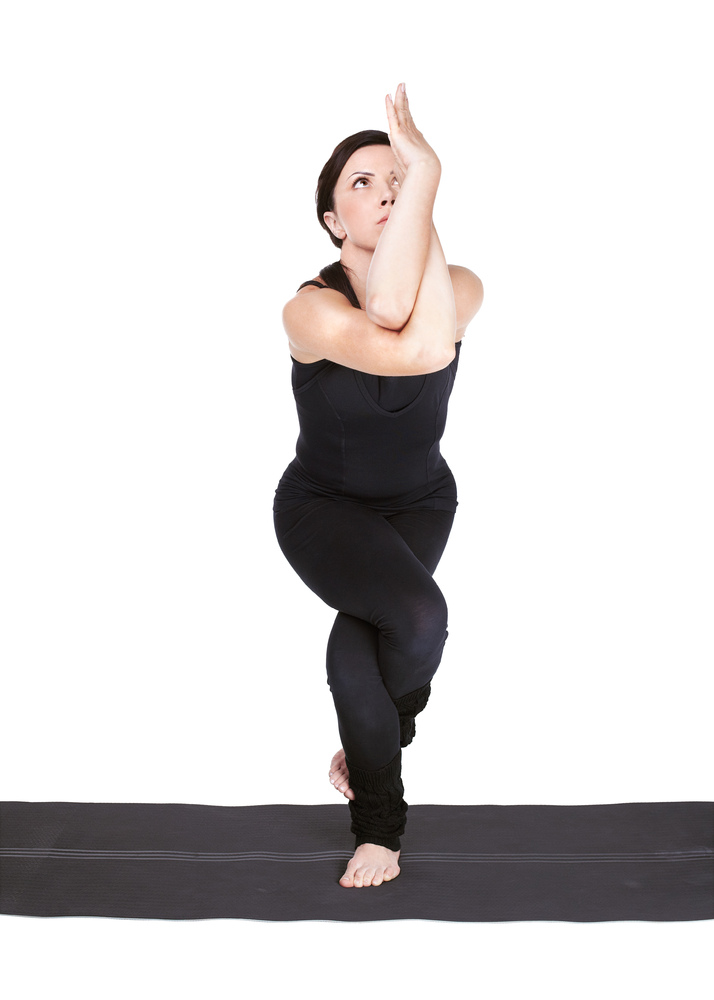 """""""The symmetry we experience in practicing balancing poses helps us turn away from the mind's business and towards the body's"""