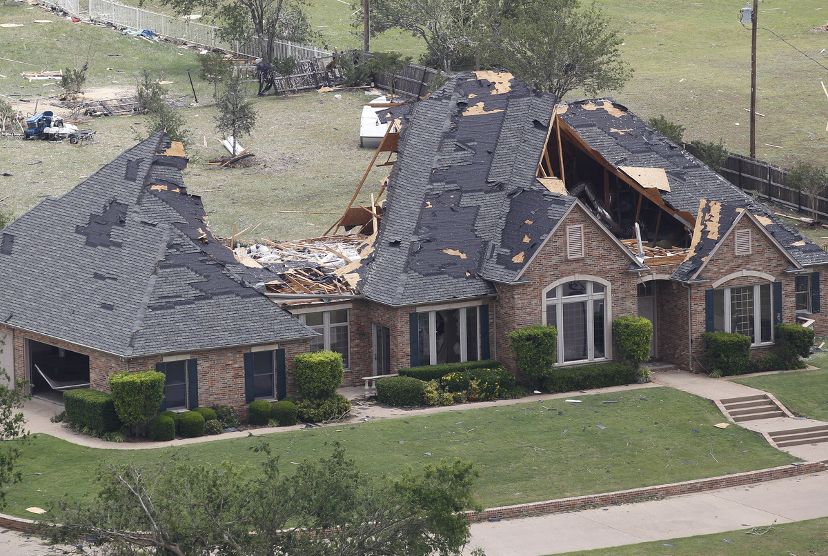 A home in Cleburne, Texas has portions of its roof missing on Thursday May 16, 2013. Ten tornadoes touched down in several sm
