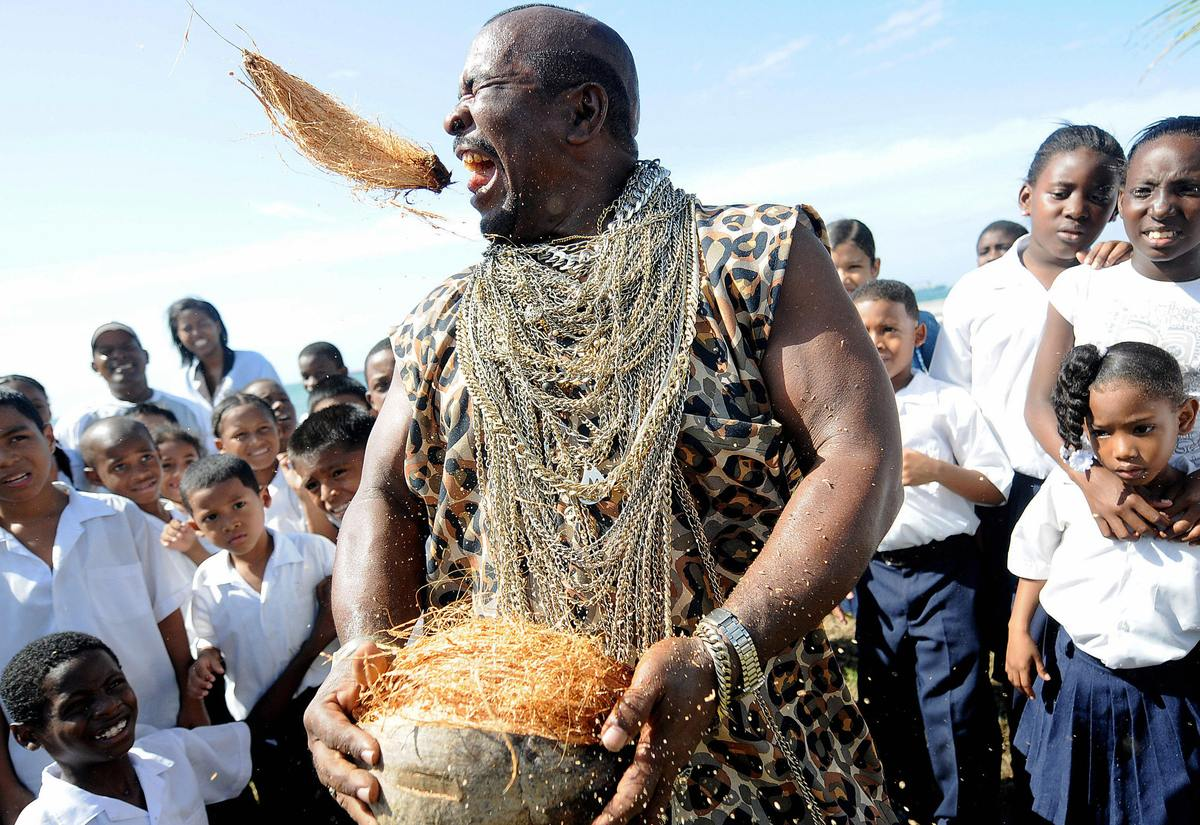 Andres Gardin, 60, popularly known as 'Coconut-peeler' performs during a public exhibition in Colon, some 100km north of Pana