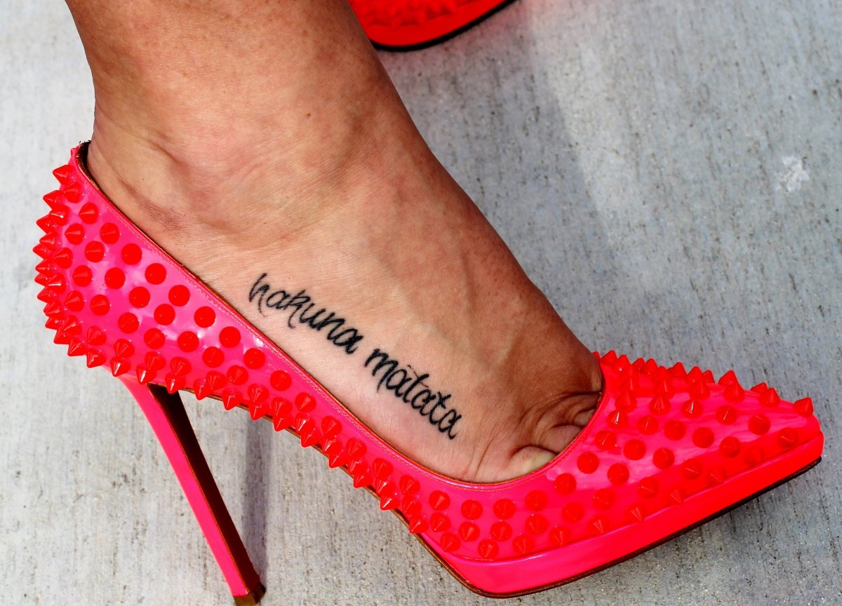 Studs are in for women…and men. As seen here by these pink patent leather Christian Louboutin limited edition shoes sporting