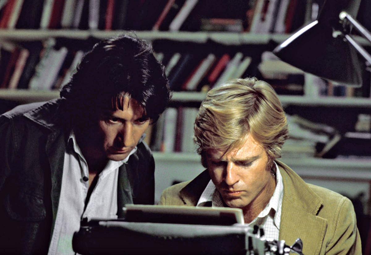 In this file photo provided by Warner Bros., actors Robert Redford, right, and Dustin Hoffman appear in their roles as report