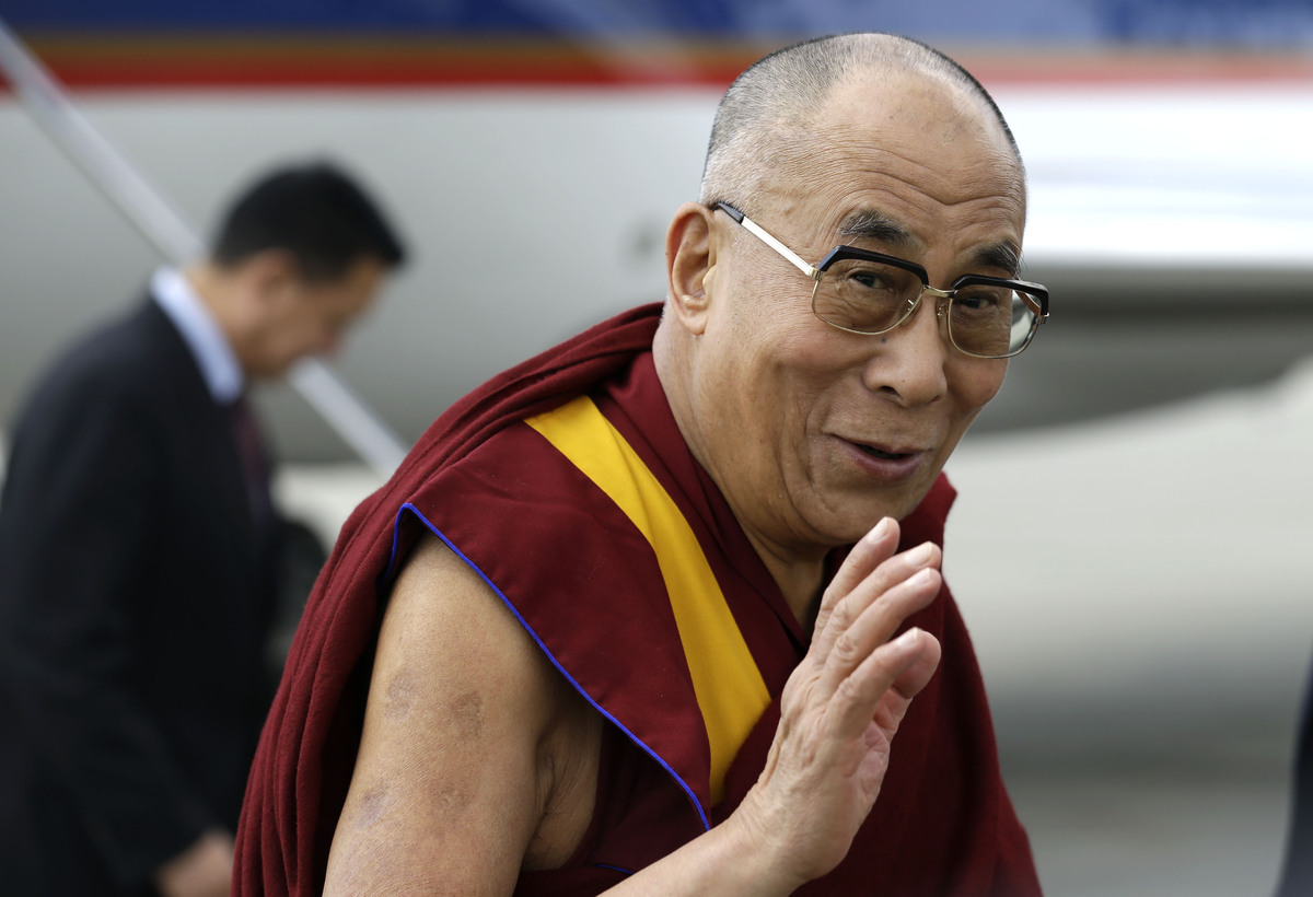 The Dalai Lama arrives at Louis Armstrong International Airport in Kenner, La., Thursday, May 16, 2013. He will be delivering