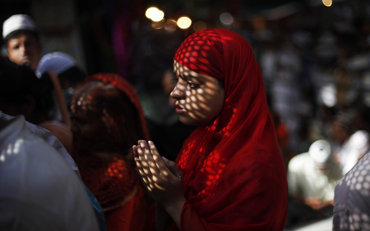 An Indian Muslim devotee prays at the shrine of Sufi saint Khwaja Moinuddin Chishti during the Urs festival, in Ajmer, India,