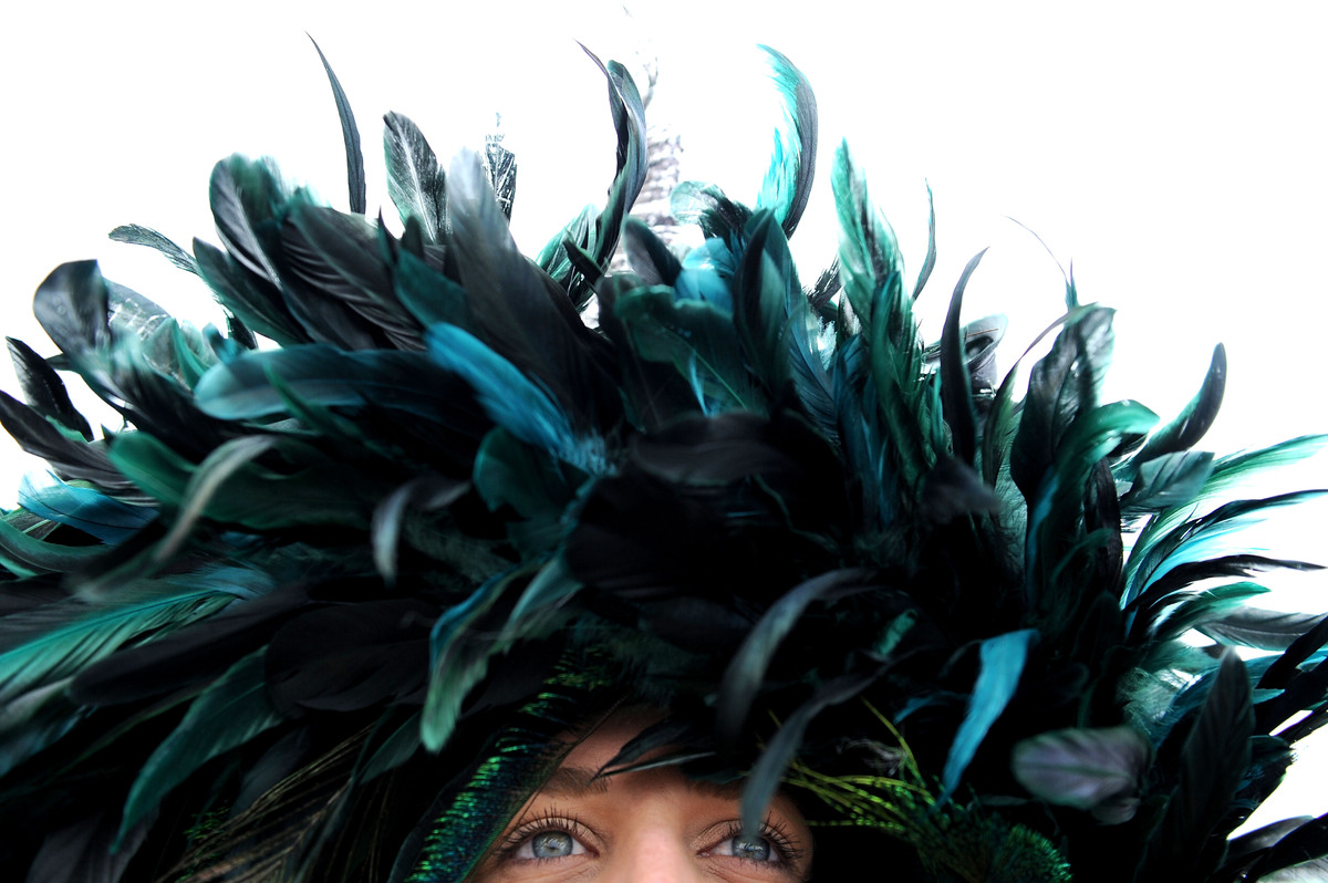 BALTIMORE, MD - MAY 18:  A detailed view of a feathered hat on a race fan in the infield prior to the 138th running of the Pr