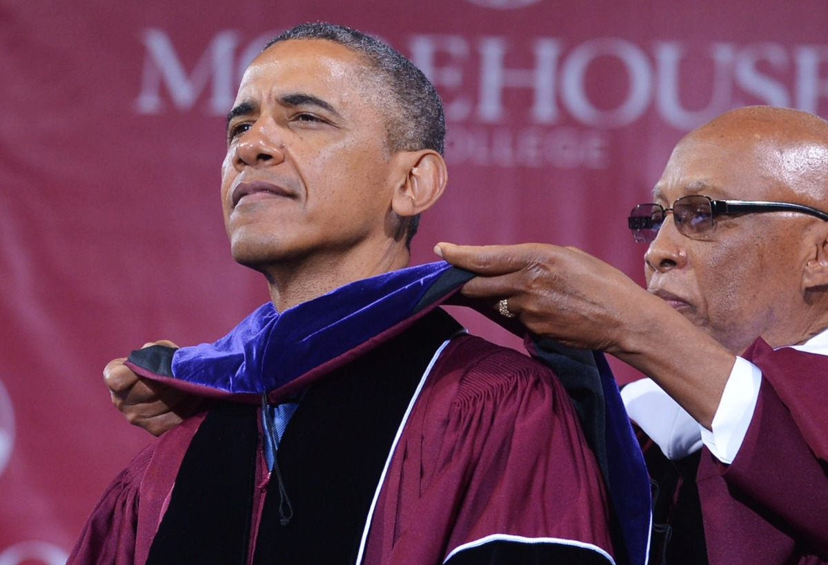 US President Barack Obama is presented with and honorary doctor of law degree after delivering the commencement address durin