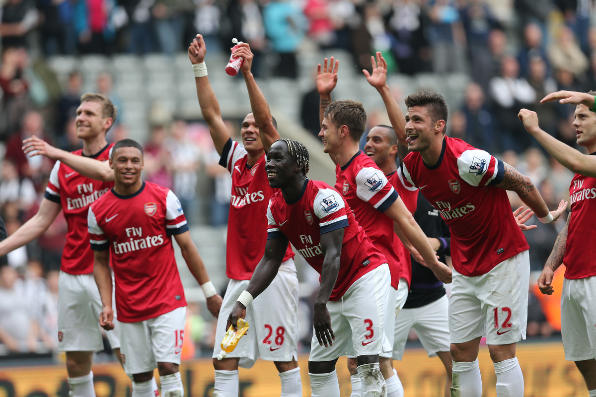 Arsenal players celebrate their victory after the final whistle in the English Premier League football match between Newcastl