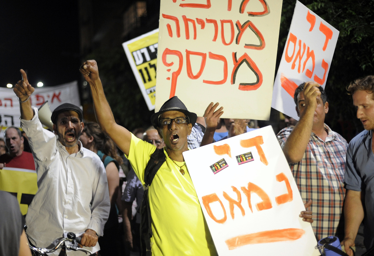 Israelis take part in a demonstration calling for social justice and against the cost of living in Tel Aviv, on May 18, 2013.