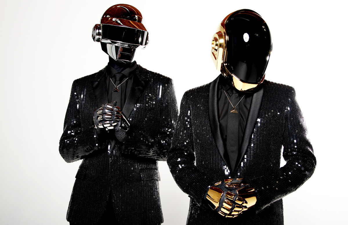In this April 17, 2013 photo, Thomas Bangalter, left, and Guy-Manuel de Homem-Christo, from the music group, Daft Punk, pose