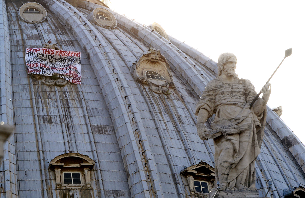 Italian businessman Marcello De Finizio stands on the dome of St Peter's basilica to protest against austerity measures on Ma