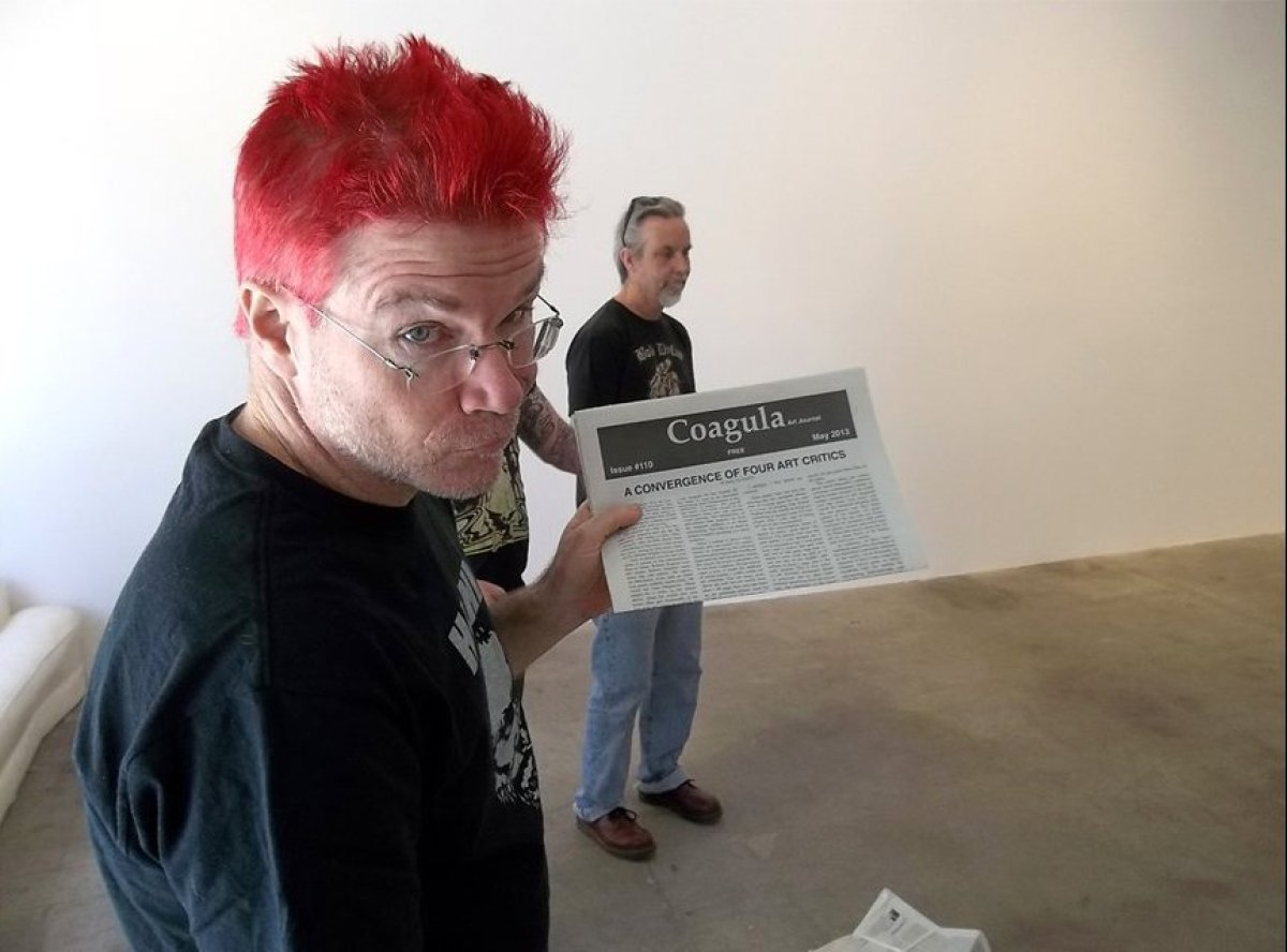 Mat Gleason, founder and editor of <em>Coagula Art Journal</em>, with the 110th issue of the magazine, marking the 21st anniv