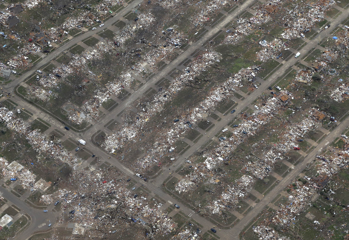 An aerial view of an entire neighborhood destroyed by Monday's tornado is shown Tuesday, May 21, 2013, in Moore, Okla. At lea