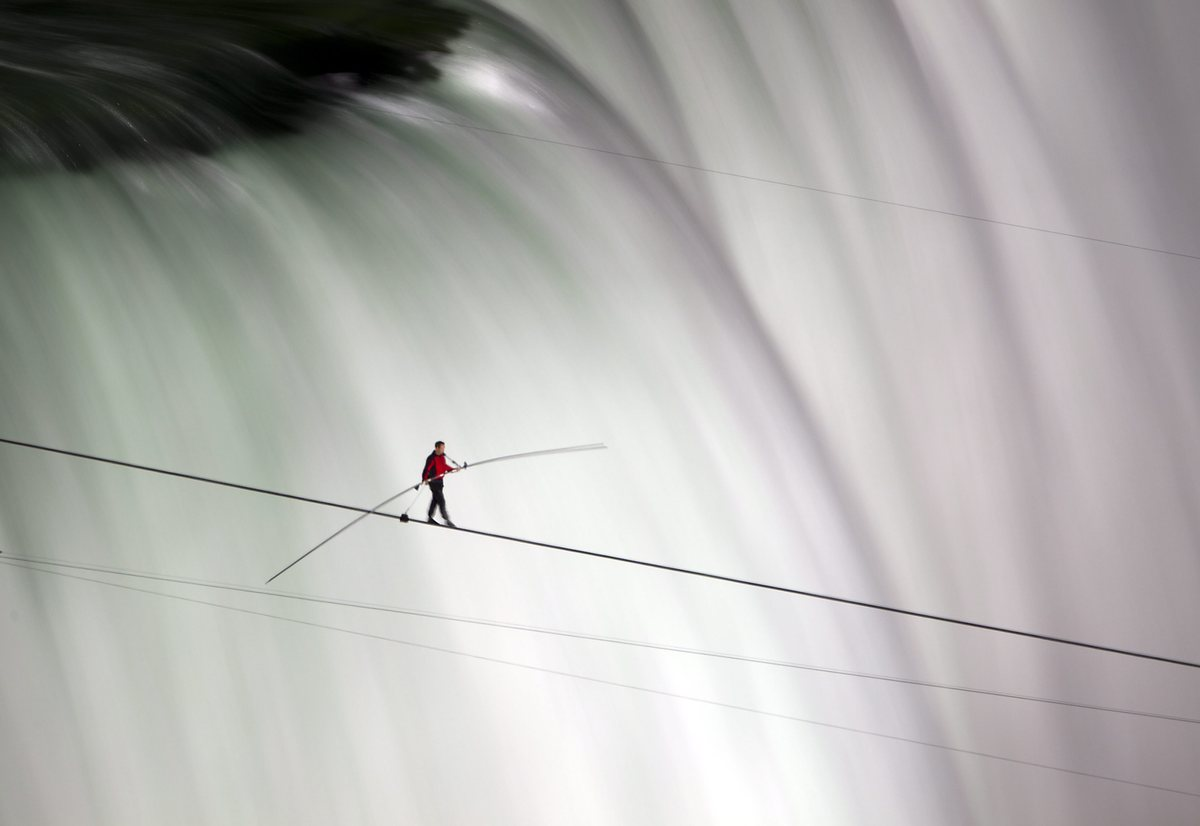 FOR USE AS DESIRED, YEAR END PHOTOS - FILE -In this June 15, 2012 file photo, Nik Wallenda walks over Niagara Falls on a tigh