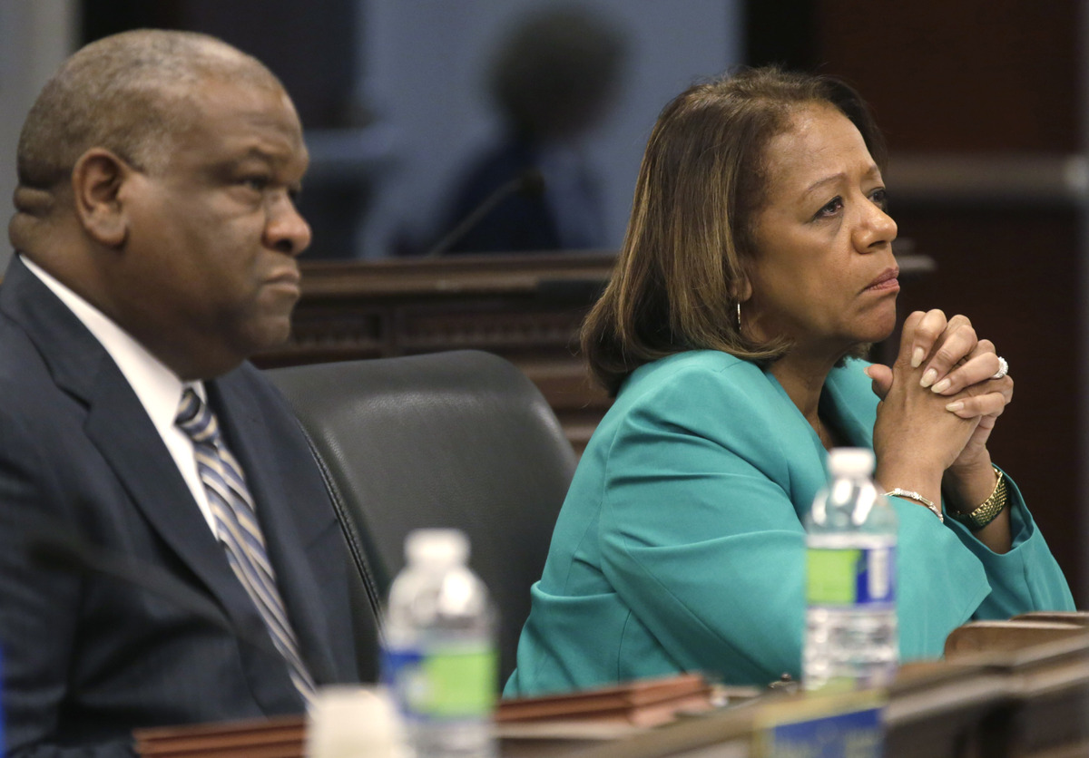 Chicago Board of Education General Counsel, James Bebley, left, and CEO Barbara Byrd-Bennett, right, listen as Chicago Teache