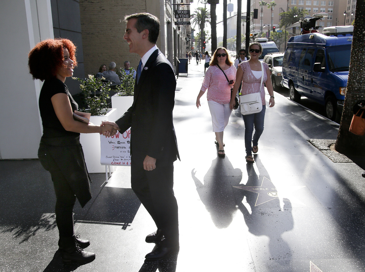 Los Angeles Mayoral candidate Eric Garcetti greets people along Hollywood Blvd. on Tuesday, May 21, 2013 in Los Angels. Garce