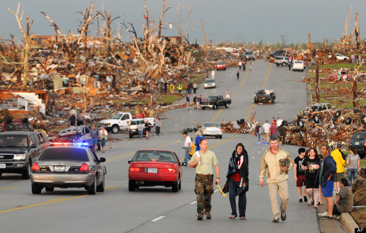 In this May 22, 2011 file photo, residents walk in the street after a massive tornado hit Joplin, Mo. (AP Photo/Mike Gullett,