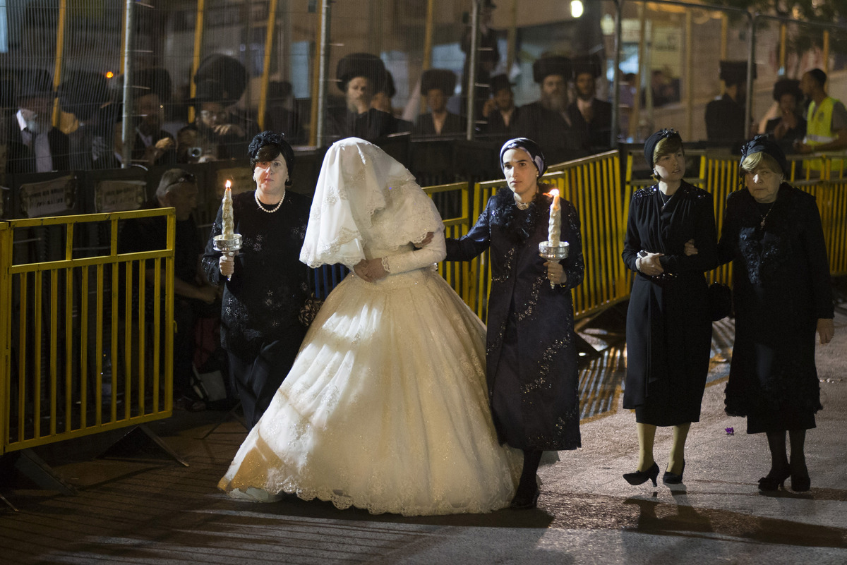 JERUSALEM, ISRAEL - MAY 21:  Ultra-Orthodox Jewish women walk with Hannah Batya Penet, the bride of Shalom Rokeach, grandson