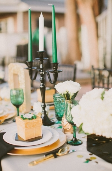 """A black candelabra adds a touch of drama to this emerald wedding.  <a href=""""http://lover.ly/explore?q=candles+lighting&ut"""