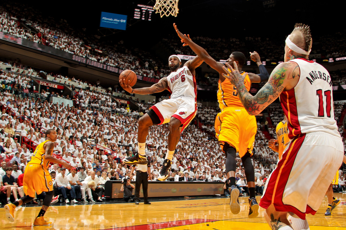 LeBron James #6 of the Miami Heat drives and makes a basket against the Indiana Pacers during Game One of the Eastern Confere