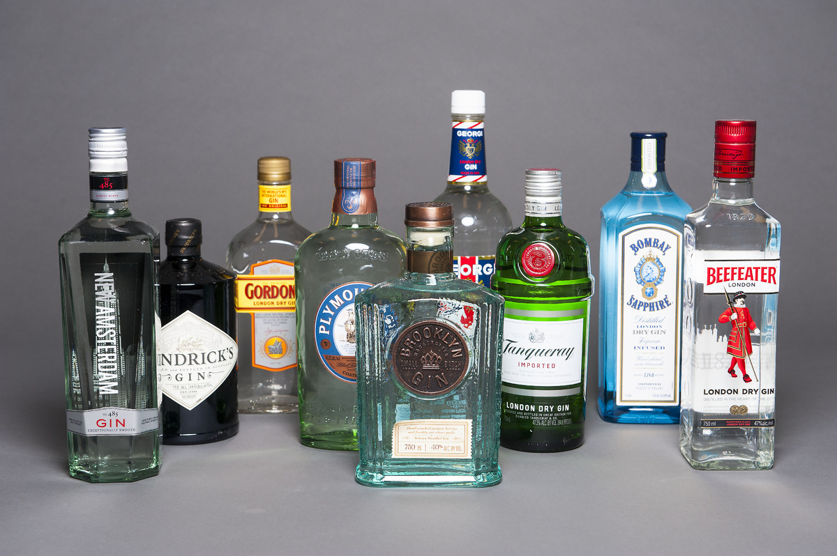 From left to right, with prices per bottle: New Amsterdam ($14 for 750 mL), Hendrick's ($41 for 1 L), Gordon's ($24 for 1.75