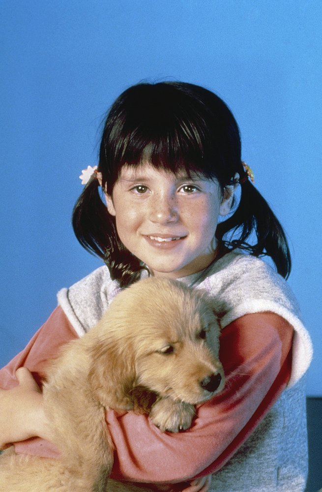 PUNKY BREWSTER -- Season 1 -- Pictured: (l-r) Soleil Moon Frye as Penelope 'Punky' Brewster, Brandon the Wonder Dog -- Photo