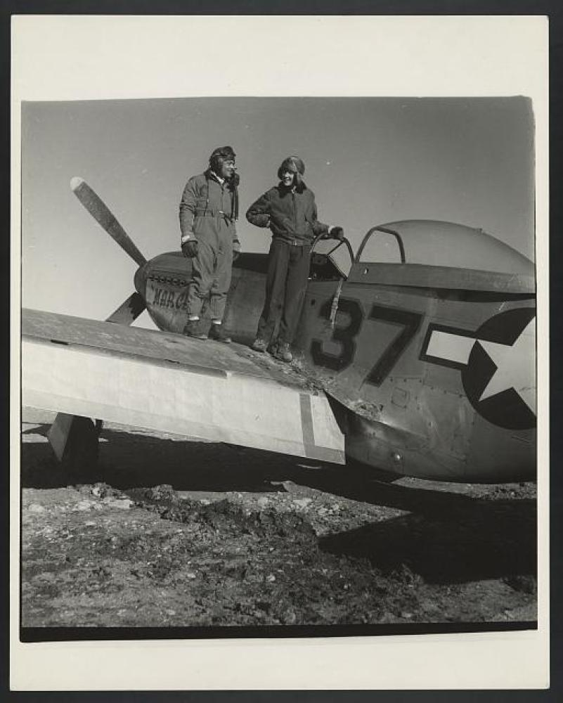 """Deputy Group Commander George S. """"Spanky"""" Roberts with photographer Toni Frissell, at Ramitelli, Italy, in March 1945. Frisse"""