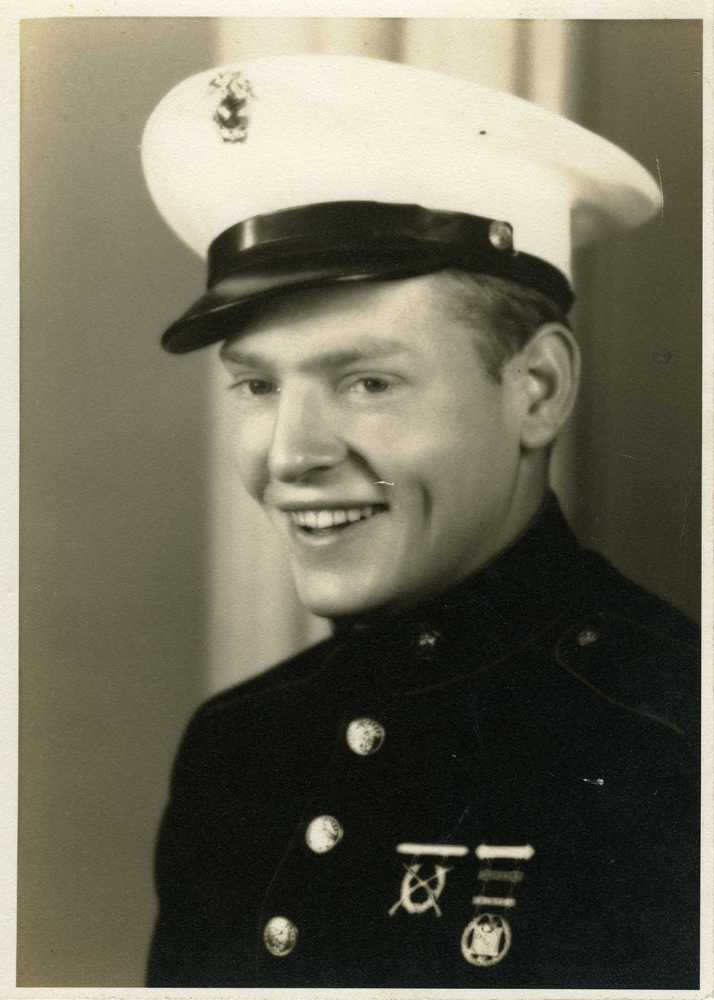 """This photo provided by the National WWII Museum shows a photo of 22-year-old Marine Cpl. Thomas """"Cotton"""" Jones, who died in t"""