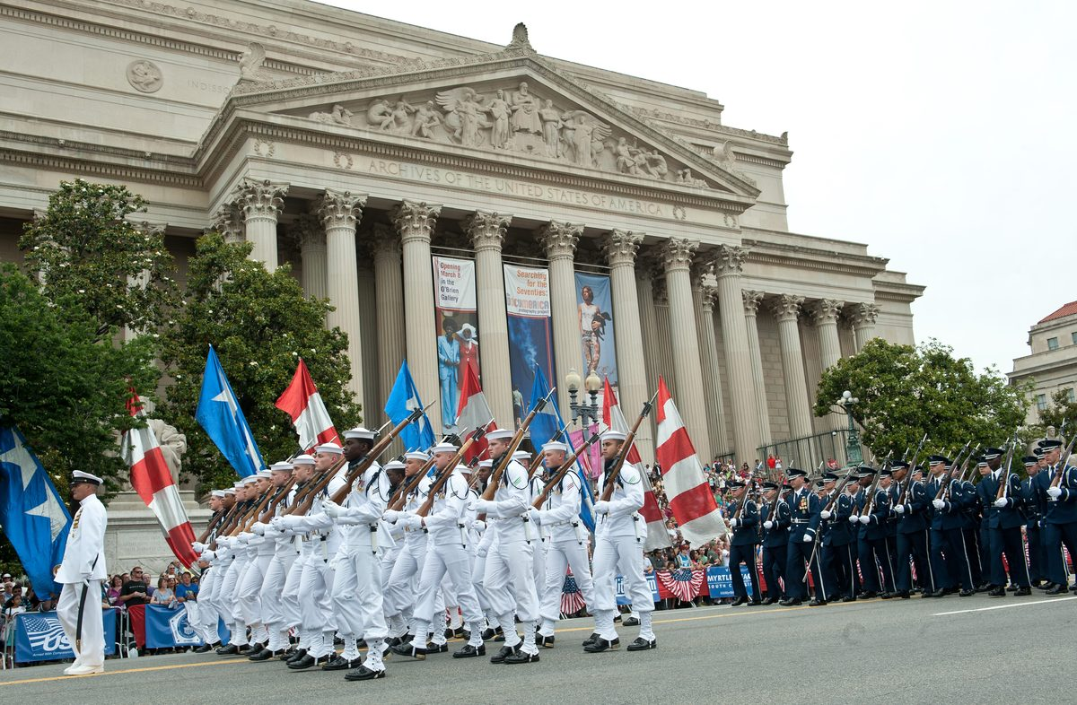 US sailors and air forcemen march during a Memorial Day parade in Washington on May 27, 2013. Memorial Day is a day of rememb