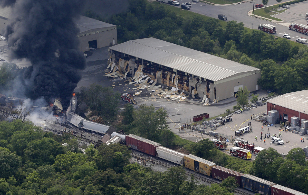 A fire burns at the site of a CSX freight train derailment, Tuesday, May 28, 2013, in Rosedale, Md., where fire officials say