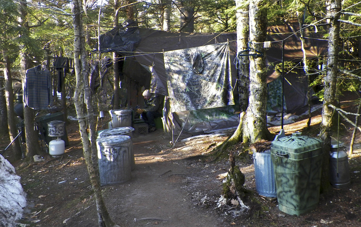 This photo released Wednesday, April 10, 2013 by the Maine Department of Public Safety shows a camp in a remote, section of R