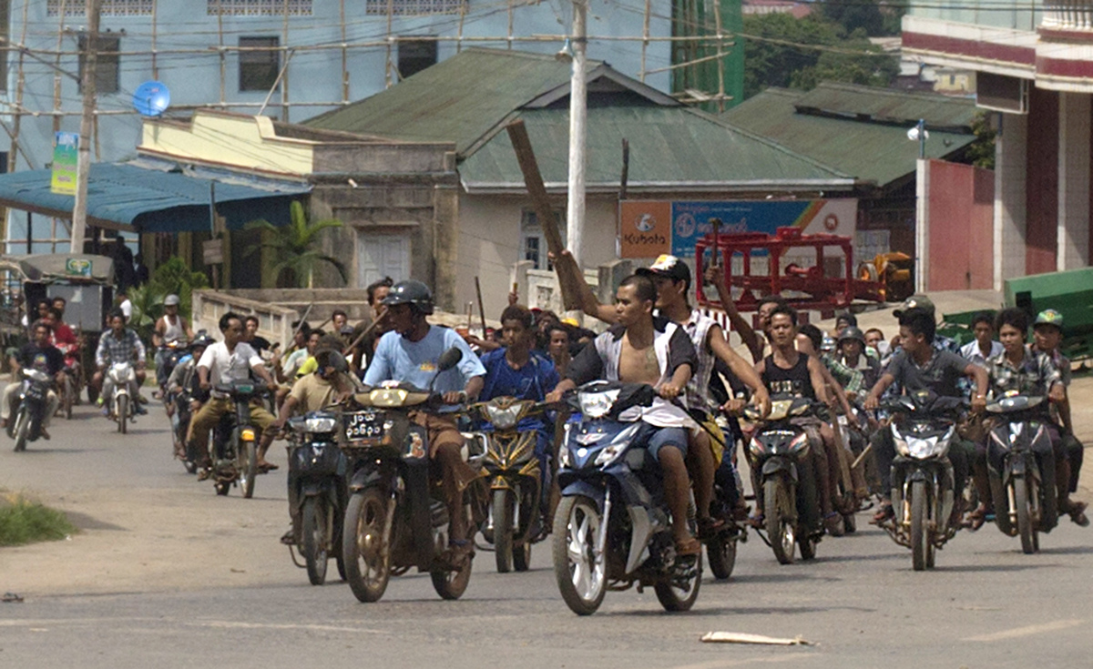 Hundreds of Buddhists on motorcycles armed with sticks patrol in the streets of in Lashio, northern Shan State, Myanmar, Wedn